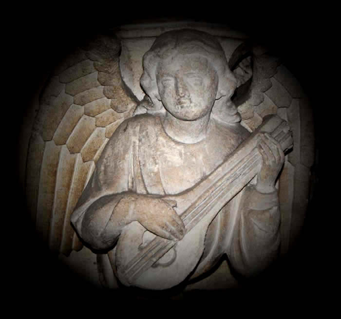 Angel with lute.